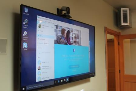 Large screen TV with camera for video conferencing