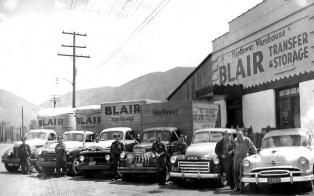 1950 - A fleet of Blair Transfer & Storage employees pose outside the Swift Building's 4th Street entrance.